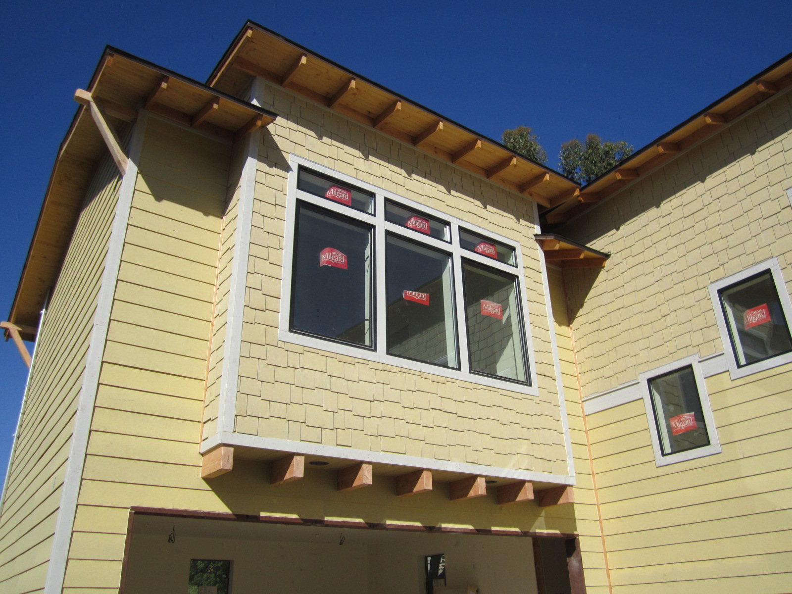 Shed Dormer with Corbels - Green Button Homes