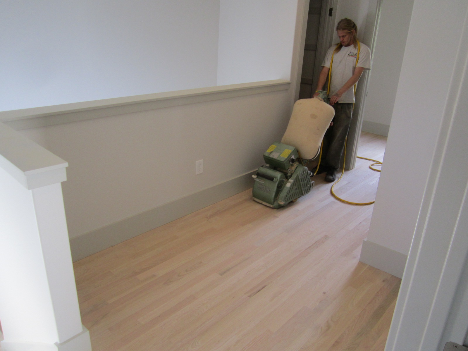 Hardwood floor refinishing green button homes for Sanding hardwood floors