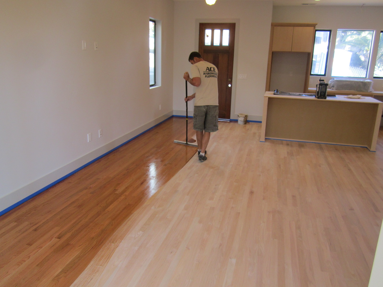 Hardwood floor refinishing green button homes for Wood floor refinishing